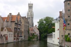 Belfry of Bruges seen from one of its many canals that earned him the name of Little Venice of the North. Belgium
