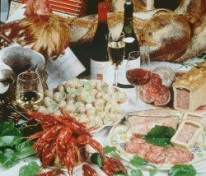A concentrate of Burgundy gastronomy with snails, crayfish, pâté en croute, sausages, Bresse chicken, bread and fine wines